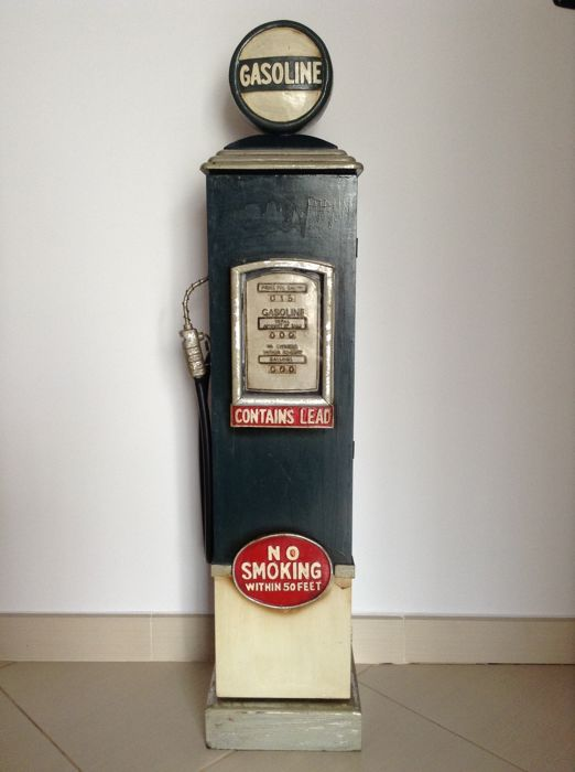Cabinet in the shape of a vintage petrol pump -suitable to store small objects or CDs - Wood