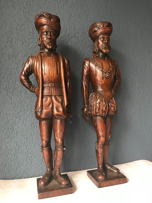 Two oak carved pieces of a nobleman with manuscript -France - around 1900