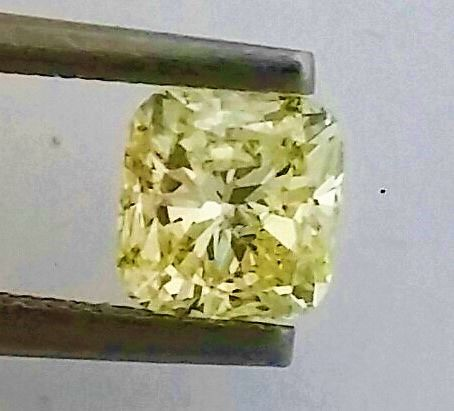 1.10 ct - SI1 - Cushion - Natural Fancy Yellow Diamond - IGL Certified + Laser Inscription On Girdle.