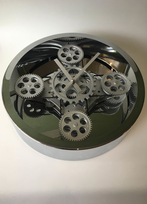 Wil van den Bos for Invotis - Wall clock with rotating cogwheels