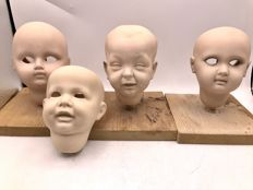4 handmade porcelain children's doll heads with restoration purposes a.o. K&R - Germany - 20th century