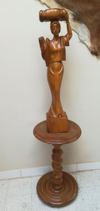 Handmade wood carvings of a woman with twisted pedestal ca