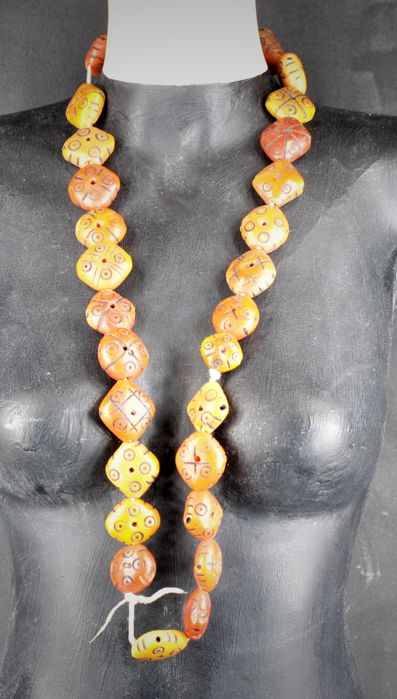 African, resin beads imitating shape and color to the old amber