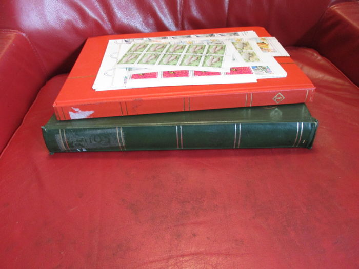 World - Batch of themed stamps in two stock books + loose sheets, mainly birds