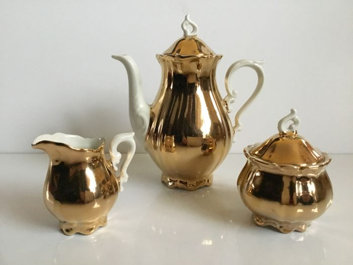 Gold colored tea / coffee set with white - Porcelain