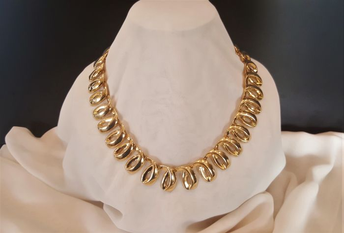 30dc2f91ac5 Yves Saint Laurent 14kt gold plated Swirl Necklace - Catawiki