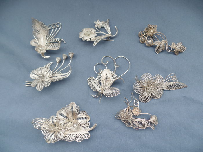 925 Silver - 8 filigree brooches with floral motifs