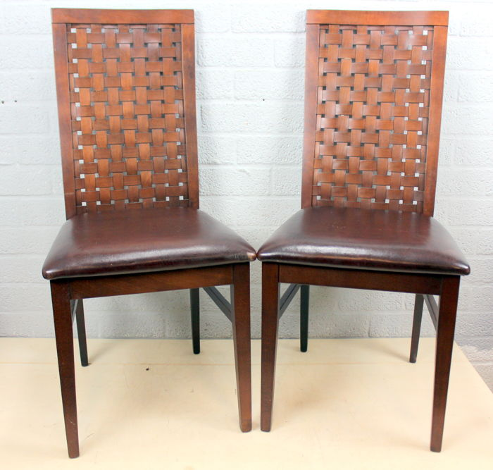 Two dining room chairs with braided handrail and leather seat