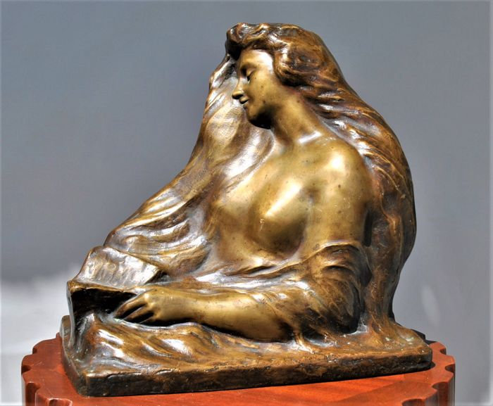 G Ouvière - Profile of woman in bronze