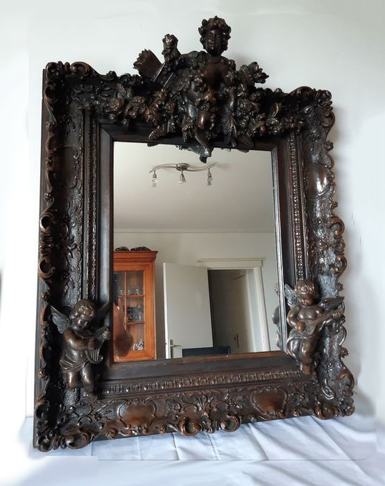 Mirror with Amor and his attributes