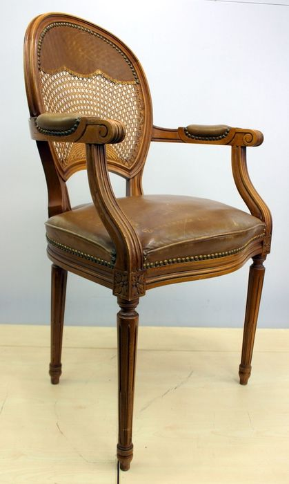 Medallion armchair with cannage and upholstered in leather - Louis XVI Style
