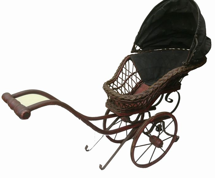A children's doll pram - Various materials: Willows; wood; metal and dust.