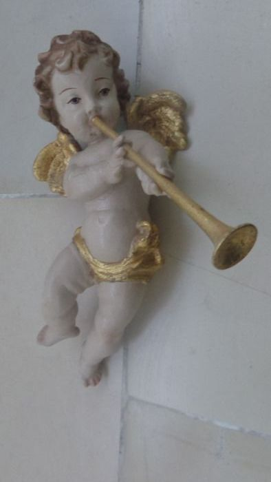 colored wood angel with wind instrument trumpet wall sculpture - Wood