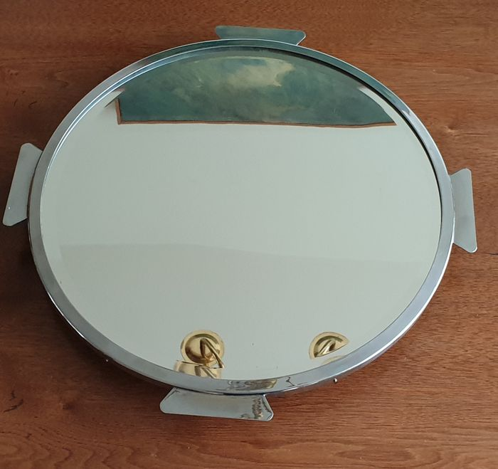 Rotating chrome serving tray with a mirror