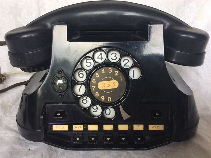 ATEA Belgium - A black metal telephone with bakelite handset and interconnection system and switch box, 1950s - Bakelite