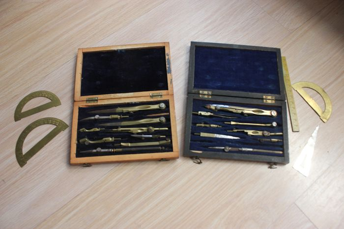 2 boxes with various instruments (compass, rapporteurs, ruler etc) - Steel, Wood