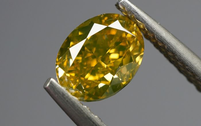 1 pcs Diamond - 0.74 ct - OVAL MODIFIED BRILLIANT  - fancy intens brown greenish yellow - SI1- No Reserve