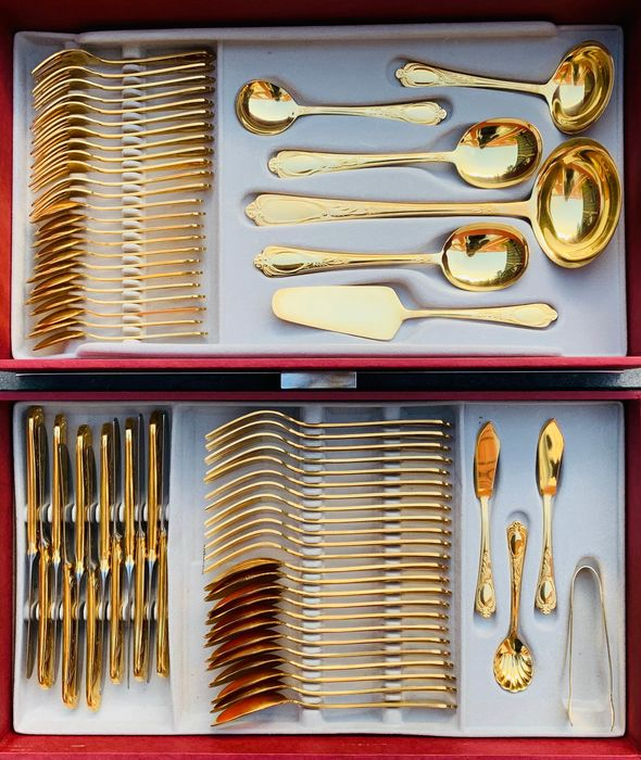 23/24 carat golden cutlery - 70 pieces - SBS Solingen - with storage cabinet - gilded hard