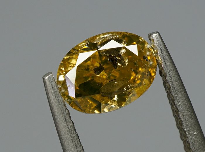 1 pcs Diamond - 1.02 ct - OVAL BRILLIANT  - fancy brownish yellow - I2 - No Reserve