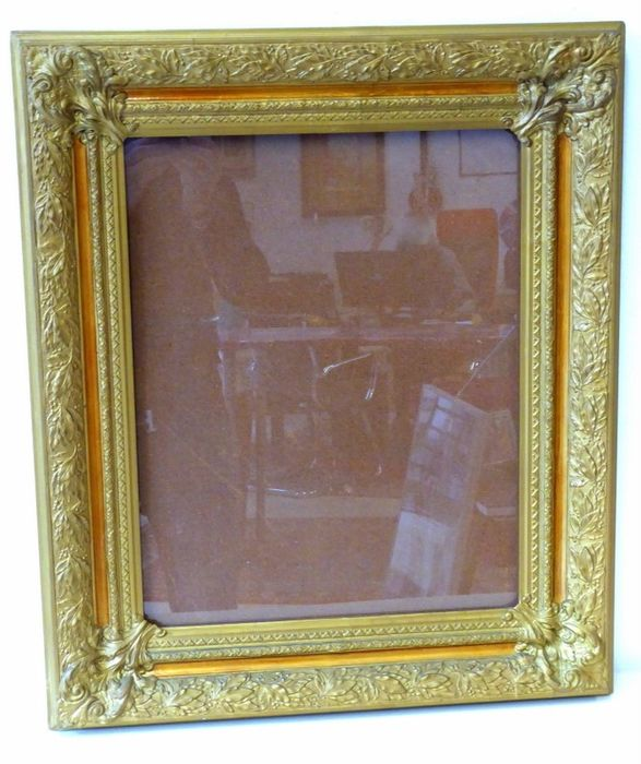 Frame cut by hand and decorated in gold With glass
