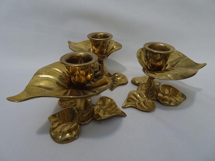 Set of three yellow copper candlesticks decorated with leaves. 1970s. - Copper