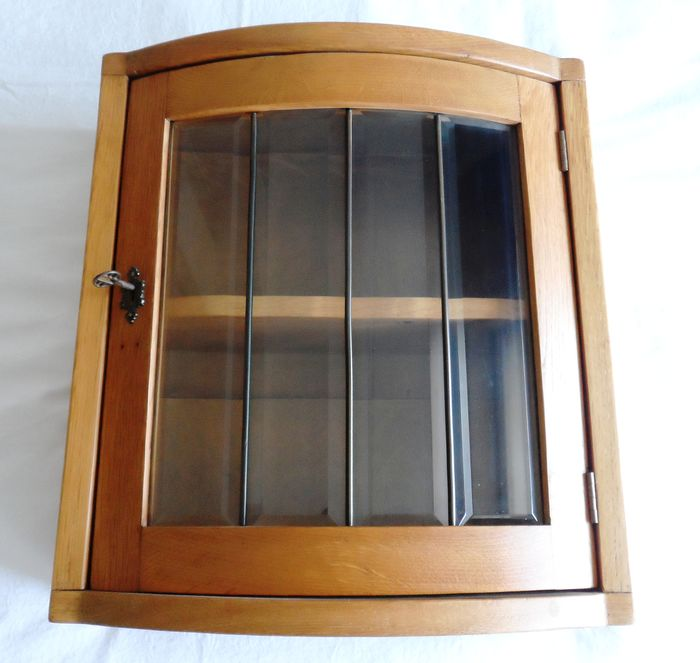 A clear oak wall cupboard with faceted glass - clear oak, faceted glass