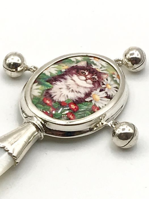 Handmade 1st grade silver rattle with mother-of-pearl handle. - .925 silver