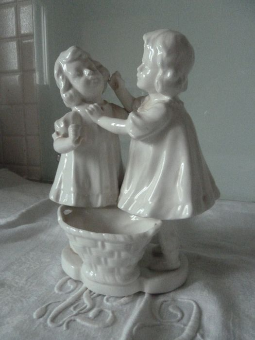 two little girls playing white porcelain subject (1) - porcelain