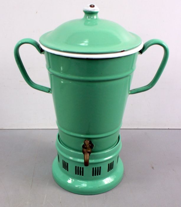 Antique enameled tap jug on a stove - enamel and metal