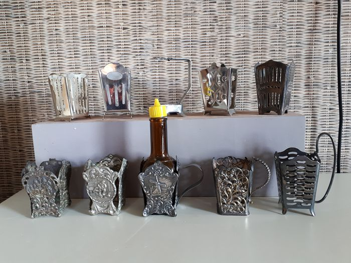 Maggi bottle holders (10) - Various metals including silver plated