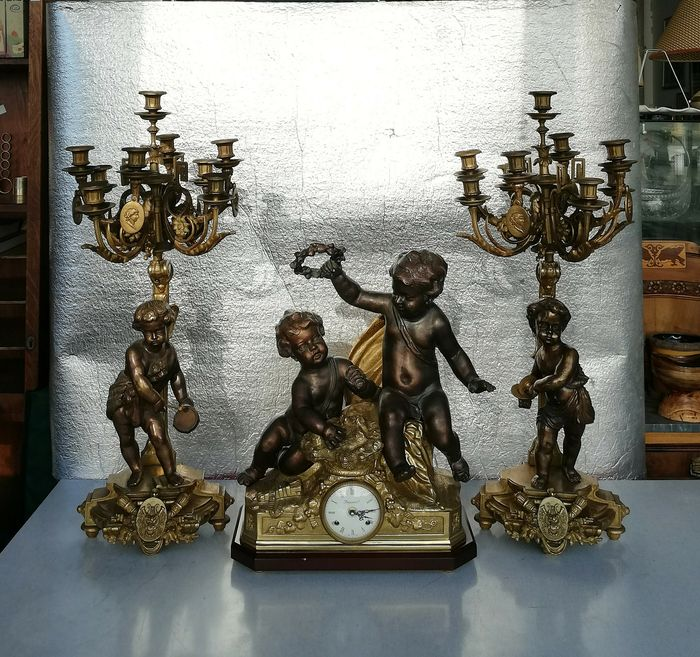 Putti with clock and candelabra - Bronze (gilt/silvered/patinated/cold painted), Wood - Late 20th century