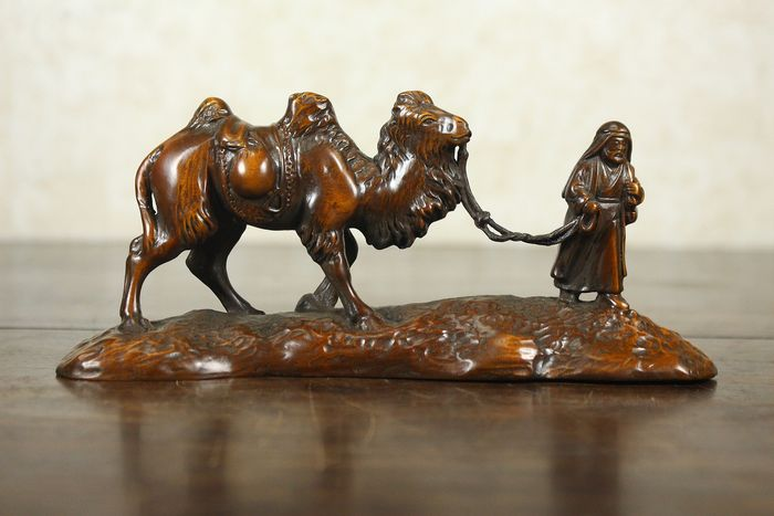 Decoration - STAINED WOOD - A CARVED  CAMEL AND DESERT TRAVELER - China - Late 20th century