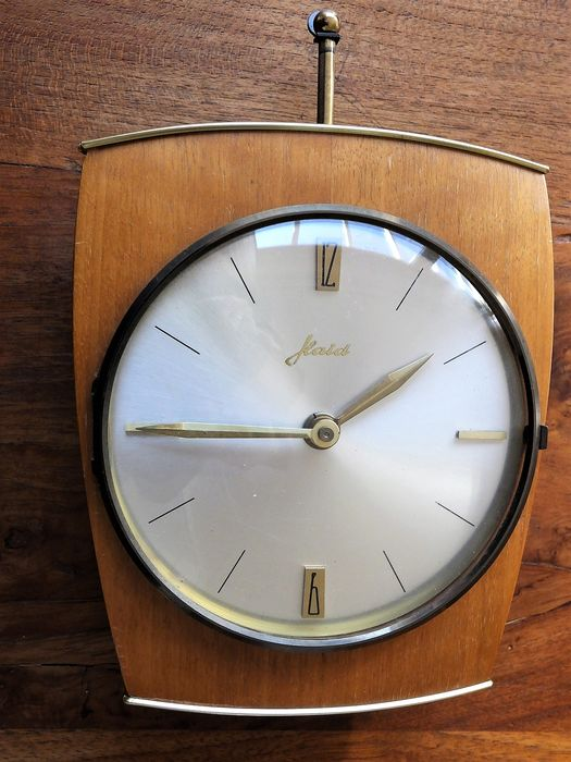 Separate small wall clock with electrical mechanical movement. - Glass, Wood