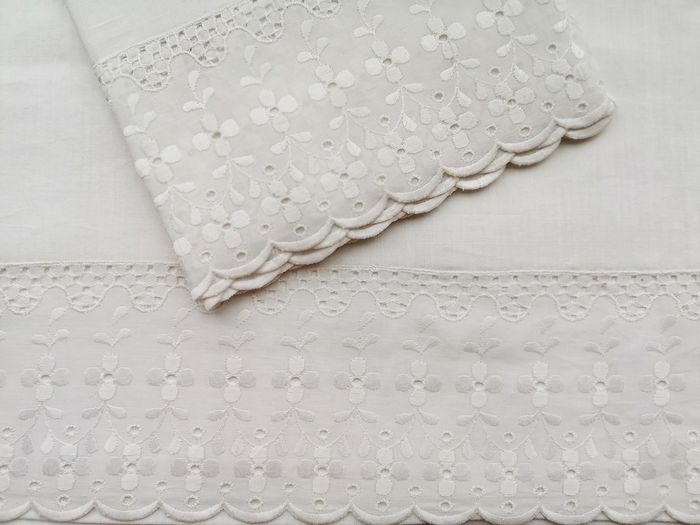 Bedding set with strips of Swiss embroidery, countertop sheet and pillow. Unused.