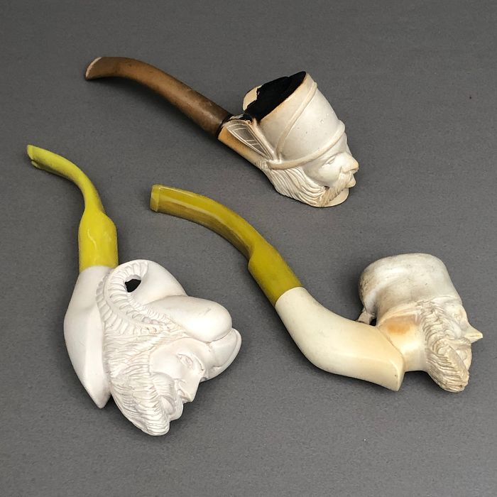 Unmarked - Three figural pipes