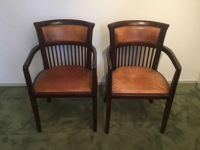 Two wooden chairs with armrests and leather seats. - Wood