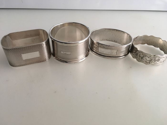 Broadway & could/ William Adams ltd / Henry Griffin &sons ltd / Joseph Gloster ltd - 4 assorted sterling silver napkin rings (4) - Silver