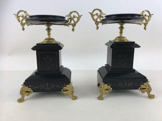 Pair of chimneys with bronze frames