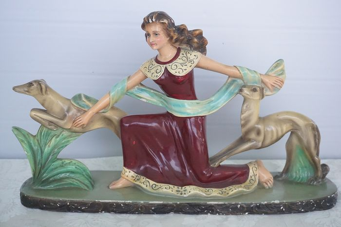 Art Deco image of girl with greyhounds - Plaster