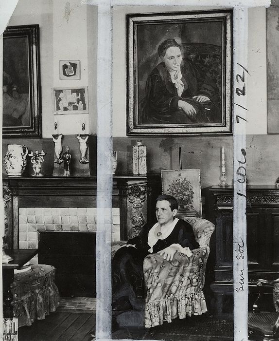 Therese Bonney (1894-1978) / International News Photos - Gertrude Stein with her portrait by Picasso, c.1920s