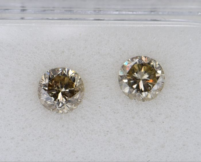 2 pcs Diamant - 0.82 ct - Rond - fancy yellowish brown - SI2, No Reserve Price!
