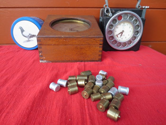 mother clock, junior pigeon clock, ring boxes (3) - Iron (cast/wrought)