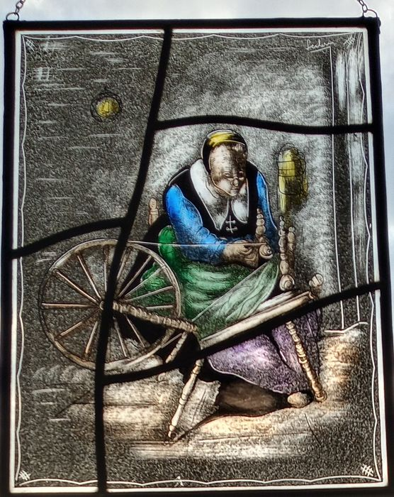 """Herman Leenders (senior) - Window, spinning with wool on the spinning wheel """" - Stained glass"""