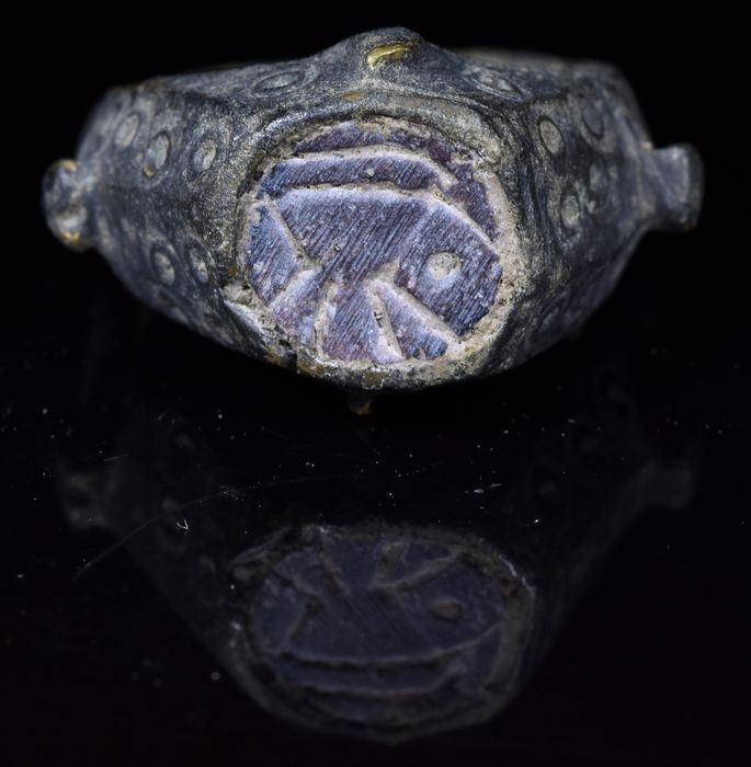 Ancient Roman Bronze Astrological Ring with Gem and Sun Symbols