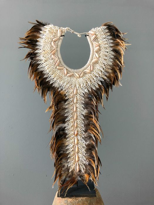 Feathers & white cut shells woven onto natural fibres - Decorative Shell Necklace with Custom Stand