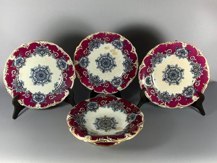 3 plates and a matching serving dish. (4) - Antique