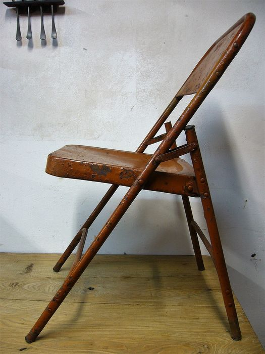 Old industrial metal folding chair
