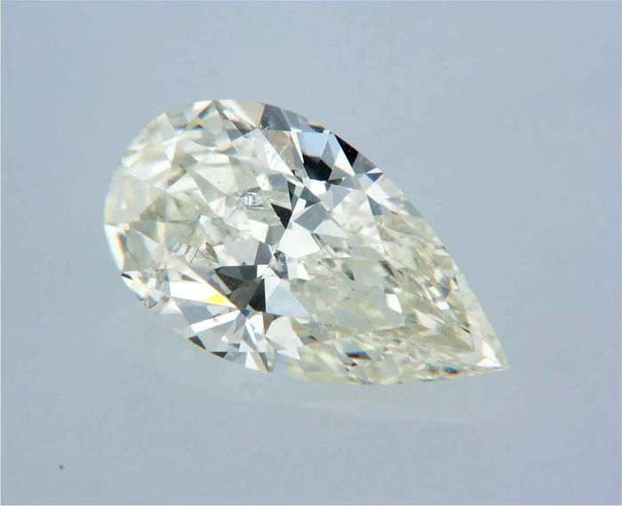 1 pcs Diamante - 0.55 ct - Pera - J - SI1
