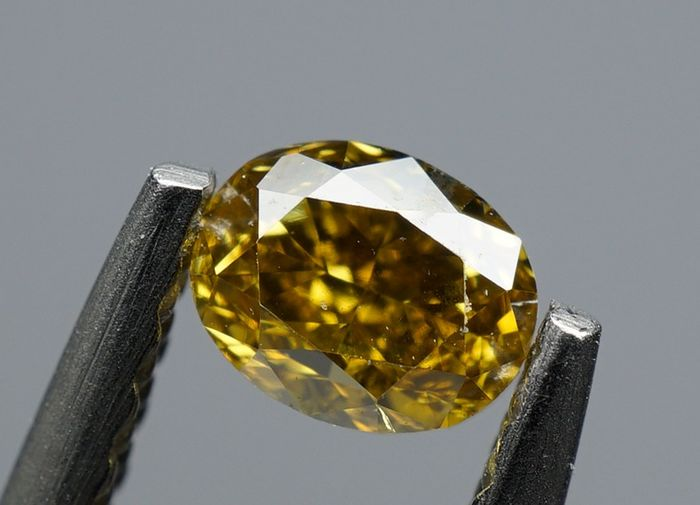 1 pcs Diamant - 0.31 ct - OVAL BRILLIANT - fancy intens brownish yellow - VS2 -No Reserve