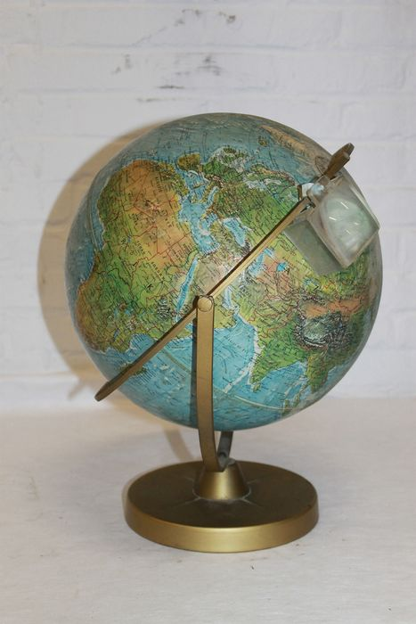 Globe with relief - on a heavy iron base